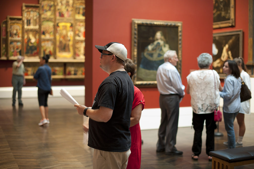 Patrons guests looking at artwork at the Meadows Museum at Southern Methodist University